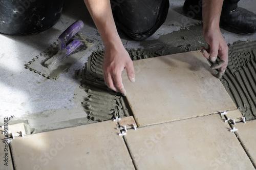 Closeup of tiles installation on the floor.