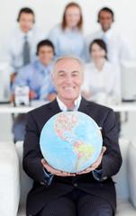 Senior manager holding a terrestrial globe