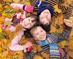 Children in autumn leaves