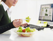 businesswoman eating salad