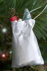 Decorative little Santa Claus sack hanging on the Christmas tree