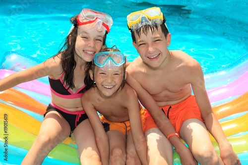 Smiling children in pool