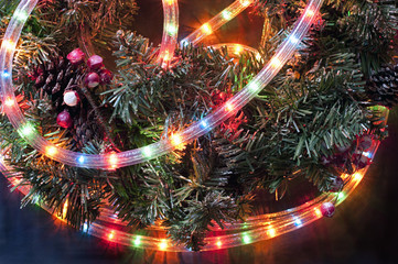 Detail of a Christmas garland with colored twinkling tube-lights