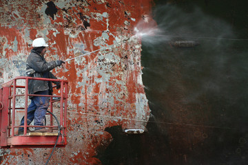 scraping surface before painting ship