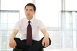 young asian business man sitting on table