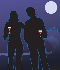 couple standing in moonlight and holding wine glasses