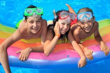 Three kids in the pool