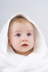 Infant in towel.