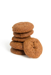 Home baked pepernoten cookies over white background
