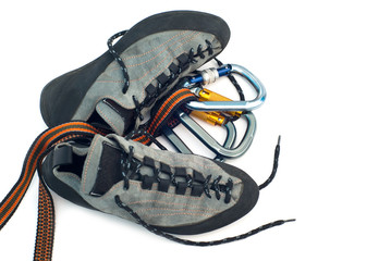 carabiners and climbing shoes