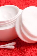 cotton pads and facial creme