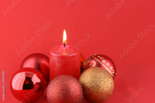 Christmas still life with red candles and balls