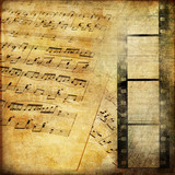 Fototapety vintage background with musical pages and filmstrip