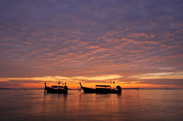Thailand. Phi Phi. Magic sunrise scenery with thai boats