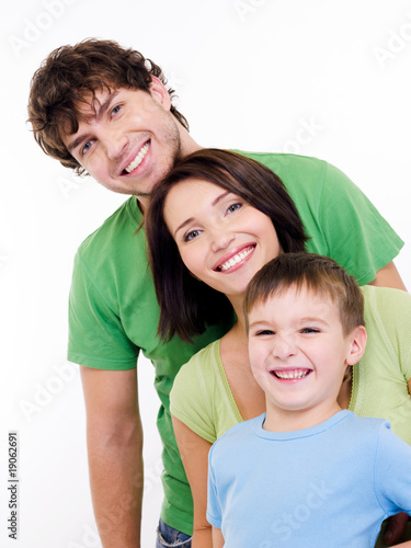 Happy faces of an young family