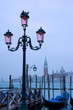 Street lamp and gondolas with view of San Giorgio Maggiore