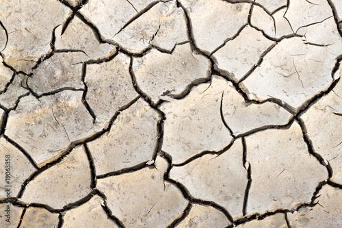 Fotobehang Droogte Trockene, rissige Erde - Textur