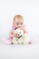 Infant with teddy - bear.