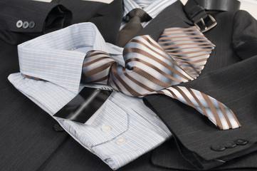 Man's jacket, shirt, tie.