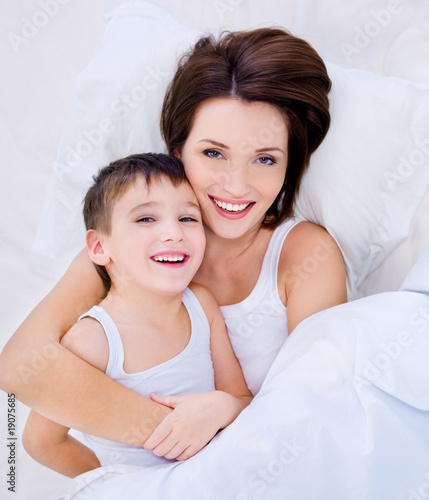 Beautioful laughing mother and pretty son