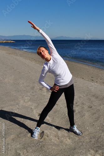 Blond woman stretching arms