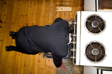 A man attempts suicide by sticking his head in an oven
