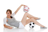 young woman clothed in sportswear with soccer ball poster