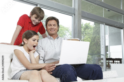 Father with kids and computer