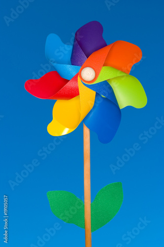 A stock Photograph of a colorful windmil toy.