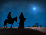 Fototapety Bethlehem Christmas. Star in night sky above Mary and Joseph