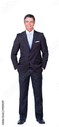 Smiling Businessman with hands in the pocket