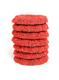 stacked red speckled christmas candy over white background poster