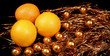 oranges over gold Christmas balls