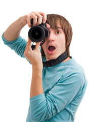 Young man surprised with photo camera