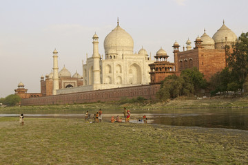 Indian family wash in the River Yamuna by the Taj Mahal