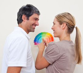 Couple with color samples to paint their new appartment