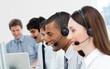 Multi-ethnic customer service agents in a call center