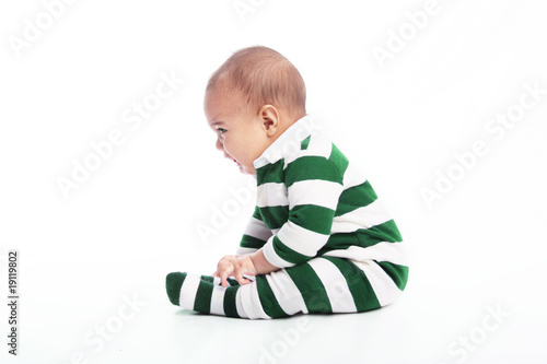 Infant boy sitting down crying
