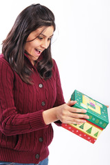Girl excited holding Christmas gift isolated