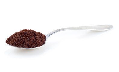 Shiny silver spoon filled with coffee