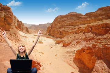 Girl with a laptop in the mountains sent the message