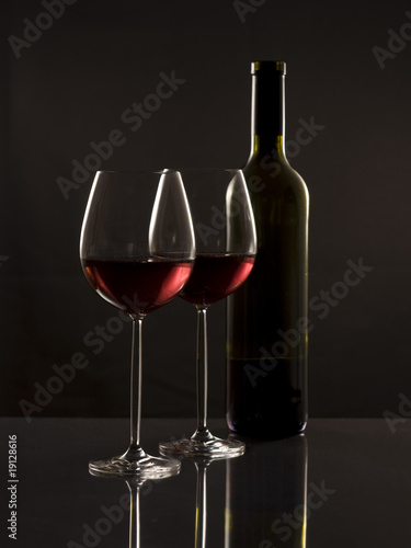 Two glasses red wine and one bottle - 19128616