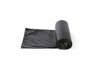 Rolled black garbage bags over white background