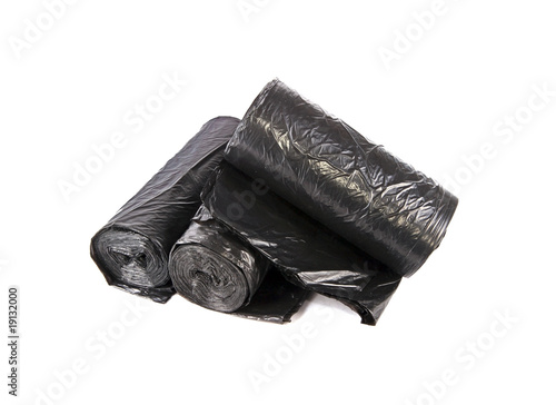 Rolled black garbage bag  packages over white background