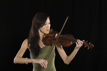 Young Asian woman plays the violin