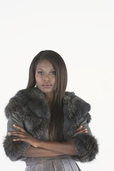 Fashion model stands with arms folded in grey fake fur bolero jacket