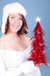 cute girl holding a red xmas tree