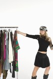 Fashion stylist with clothes rail