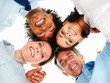 Upward view of a group of happy business colleagues with their h