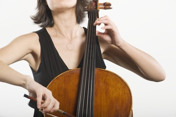 Mid section of female cellist